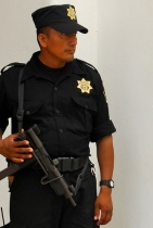 Mexican Police officer with machine gun by flickr user dream2life