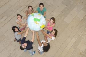 youth holding globe