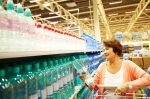woman shopping for water in big box store
