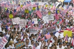 Hundreds of thousands of immigrants participate in march for Immigrants and Mexicans protesting against Illegal Immigration reform by U.S. Congress, Los Angeles, CA, May 1, 200