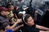 Protestors and police - Jesus Villaseca Perez (Flickr)