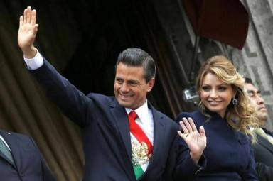 Mexico's President Enrique Pena Nieto and first lady Angelica Rivera salute during the military parade celebrating Independence Day at the Zocalo square in downtown Mexico City