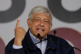 Mexican politician Andres Manuel Lopez Obrador,  leader of the National Regeneration Movement (MORENA) gestures as he addresses the audience during a meeting at Plaza Zaragoza in Monterrey, Mexico