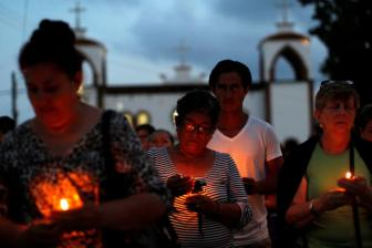 Mothers of missing sons came out of a service of  Pedro Alberto Huesca, whose remains were found at one of the unmarked graves where skulls were found on a plot of land, in Palmas de Abajo, Veracruz, Mexico