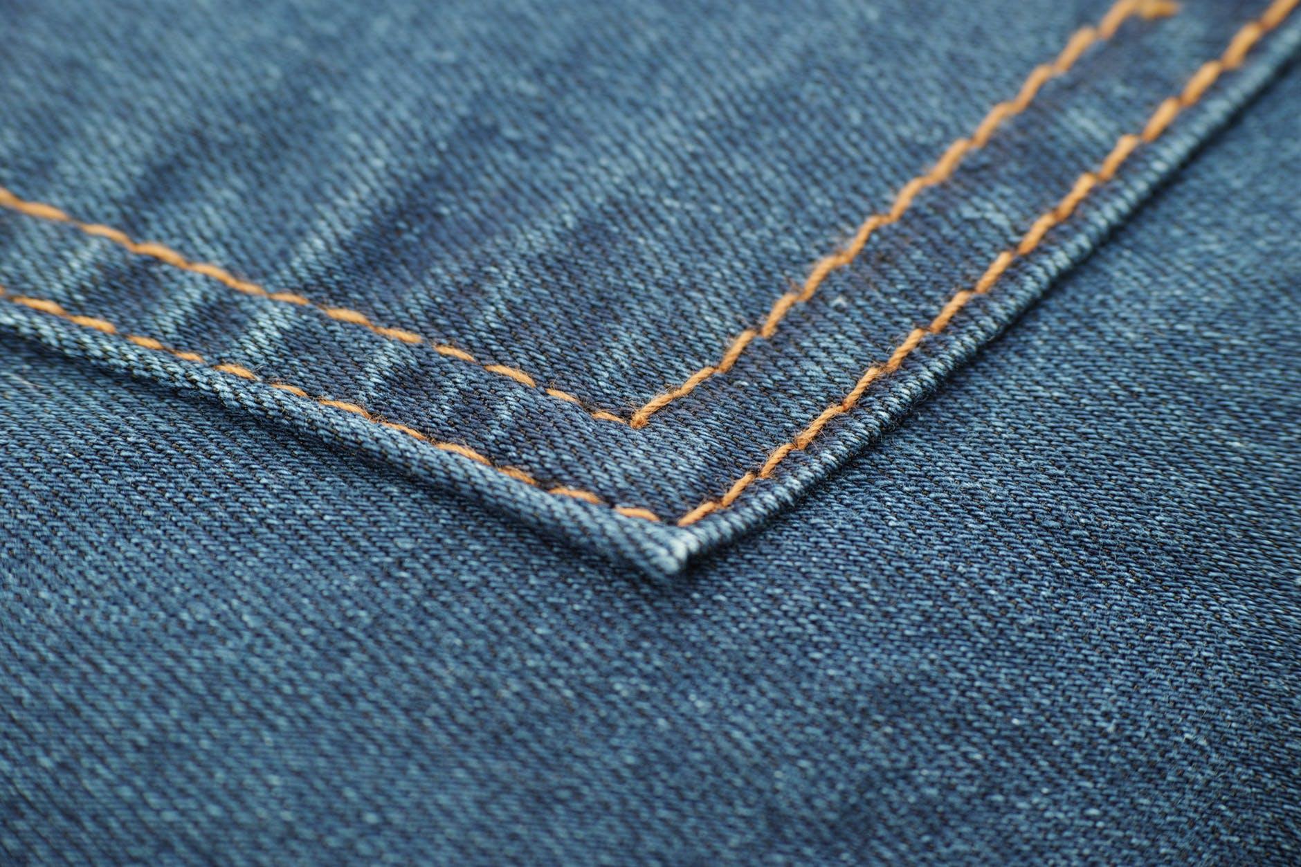 photo of blue denim textile